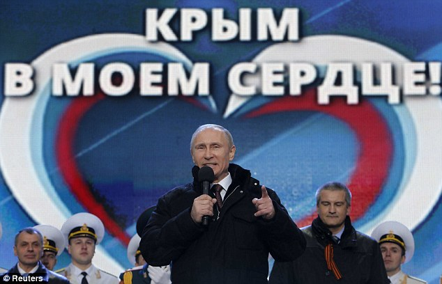 Rally: Putin speaks at an event in front of a background reading 'Crimea, we are together'
