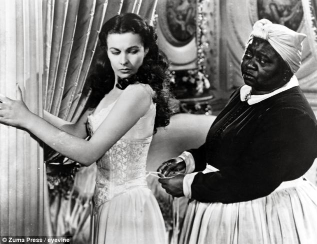 Stereotype: Much criticism stems from the fact that the principle black characters such as Mammy played by Hattie McDaniel (pictured with Vivien Leigh) are reduced to playing stereotypical maids offering up cheerful servitude