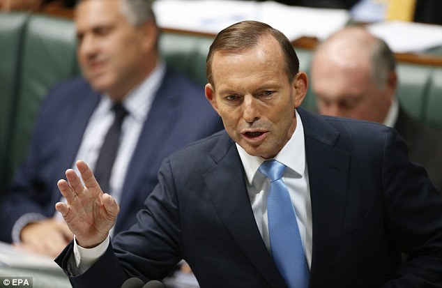 Debris spotted: Australian Prime Minister Tony Abbott pictured today in Canberra, said two pieces of debris had been spotted on satellite imagery and aircraft were being sent to investigate