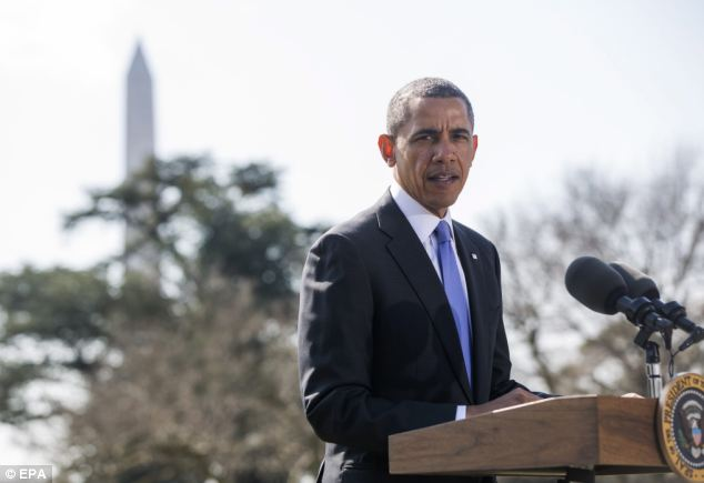 President Barack Obama addresses the Ukraine crisis at the White House Thursday, announcing new sanctions against Russian officials and a bank that holds their assets, and an executive order authorizing the government to make more moves