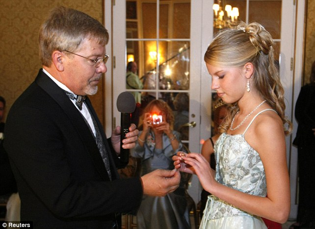 A father presents his daughter with her ring: Randy Wilson founded the first Father Daughter Ball in 1998