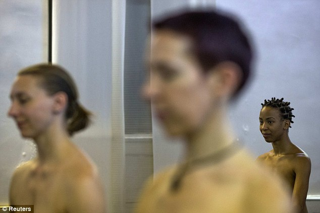 Vanessa Kennedy, a naked yoga class attendee (pictured at the back), told Reuters: 'When we're naked, it's like we're all the same'