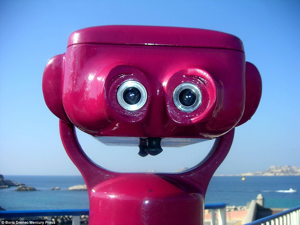 The eyes have it: Mr Smith says that with some of the coin-operated binoculars for tourists, 'can't help but smile at [them], they look so happy'