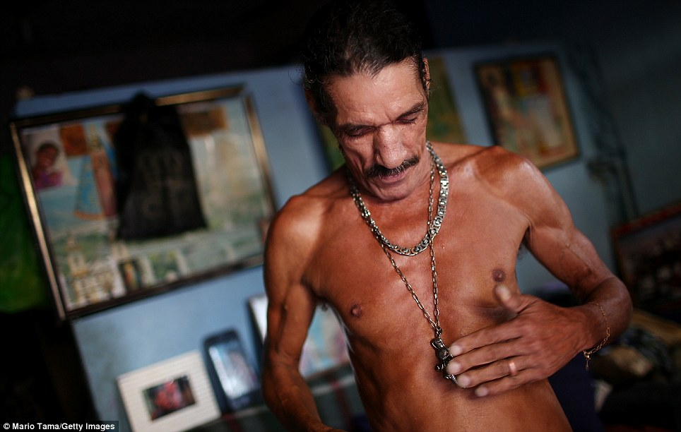 A Mare resident Louis Carlos de Sousa is pictured here. Since winning the World Cup host title and being chosen as host for the 2016 Olympics, Brazilian authorities have cracked down on violence and drug gangs in the country's major cities