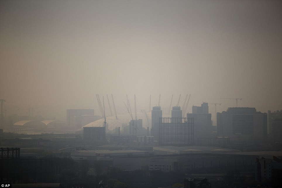 Distant: The Millennium Dome is shrouded in smog in London, as seen from a viewing gallery in the Orbit sculpture during a tour organised for the media