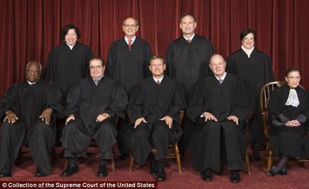 Conservative victory: Justice Clarence Thomas (bottom left) wrote that he supported the decision but would have gone further and gotten rid of all spending limits entirely