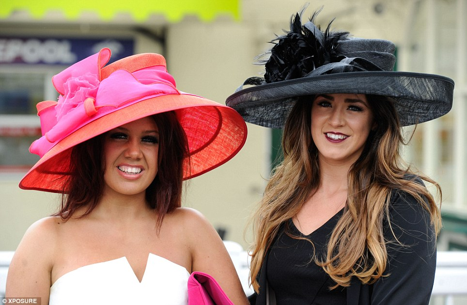Hats you win: A pair of ladies with their eyes on the £10,000 Dominican Republic holiday prize show off their feathered and ribboned headgear as they arrive
