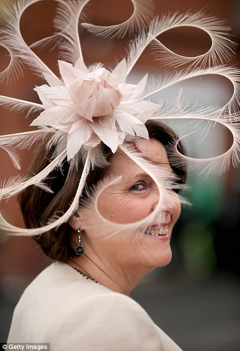 A lady shows off her spectacular hat