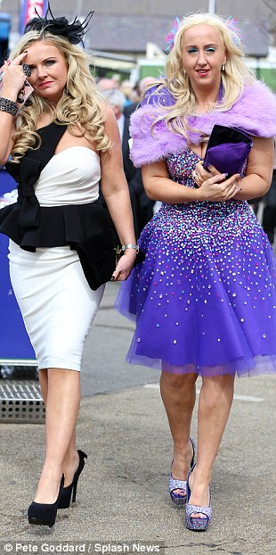 Glamorous: A pair of racegoers show off their spangled outfits and skyscraper heels
