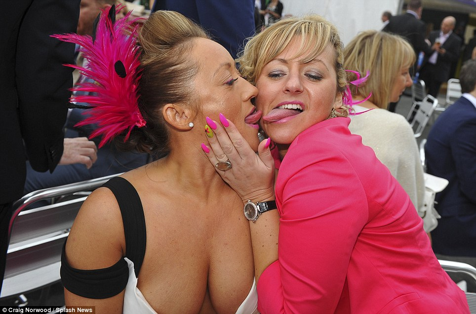 That's not very ladylike! A pair of tipsy racegoers take inspiration from Miley Cyrus after having a few too many drinks during Ladies Day at Aintree