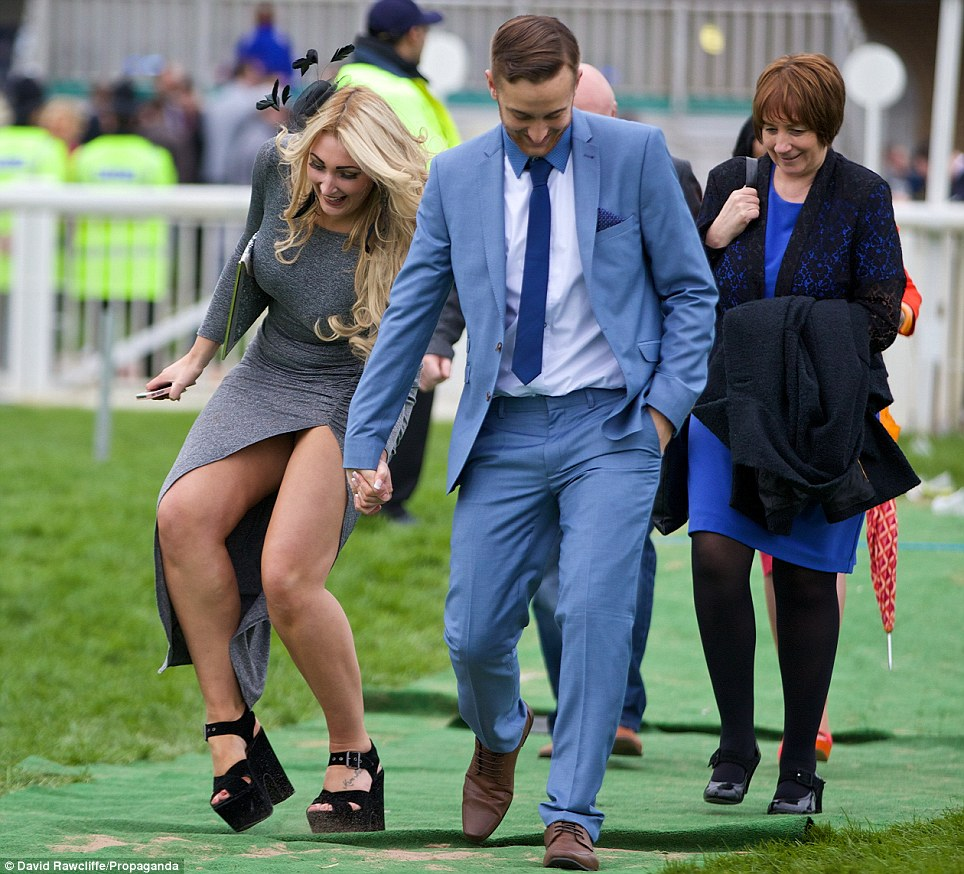 Aftermath: A few racegoers looked a little worse for wear by the end of the day and some, among them this woman, ended up looking a bit unsteady