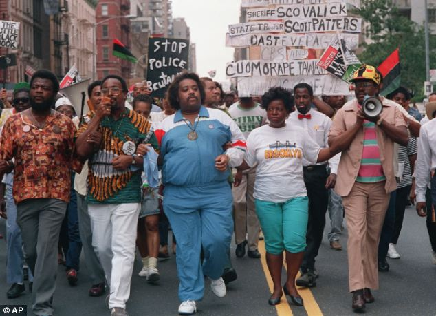 At the time: A heavier Sharpton (in blue track suit, center) is pictured during a march in 1998. Years earlier he had began informing against mob bosses, reports said