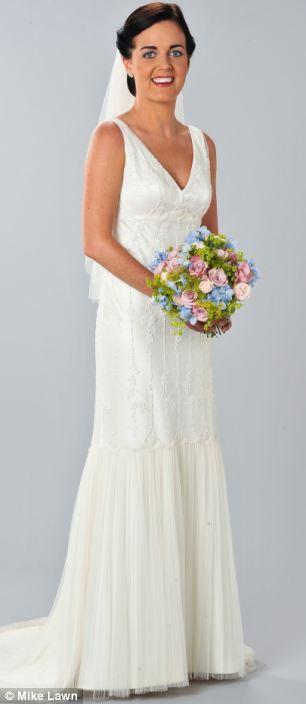 Shannon D'Almeida accessorised her Twenties-style gown with a veil, a diamanté hair clasp and satin Jimmy Choo heels