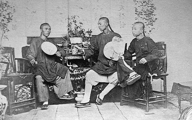 Posed: This image shows three young Chinese men sitting in their home in the late 1860s. As well as previously unpublished photographs, the collection also contains articles describing life in mid 19th century China