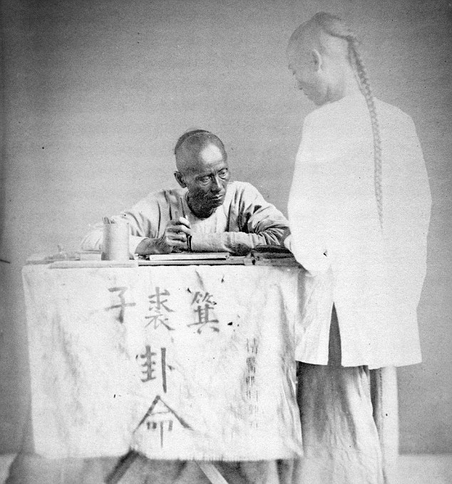 Down to business: A Chinese letter writer is photographed in the late 1860's. One intriguing aspect of the images is that they show everyday people, instead of powerful emperors or important military figures