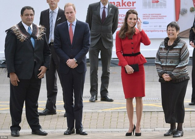 Breezy: Kate made sure to brush the hair away from her face as they stood outside of the council building in the breeze