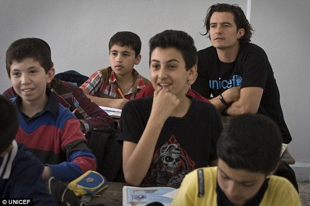 Back to school: Orlando Bloom sits at the back of the class with Syrian refugees at a school in Za'atari camp in Jordan