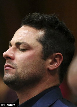 Showing the strain: Pistorius's brother Carl closes his eyes while listening to proceedings in court
