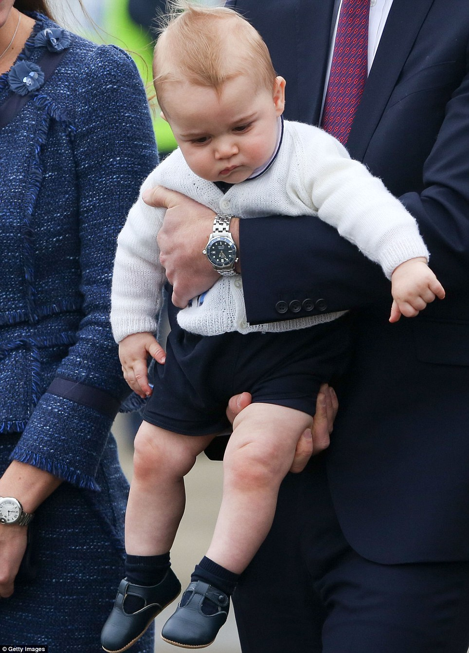 The tiny tot hasn't been particularly smiley throughout the royal tour