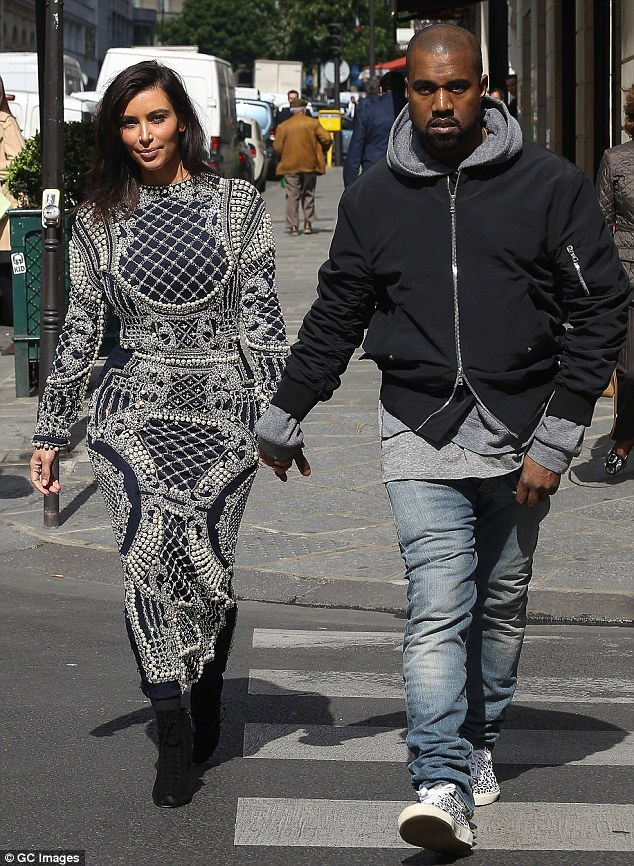 Wedding bells: The star is reportedly walking down the aisle in France with Kanye West, pictured April 14 in Paris, next month