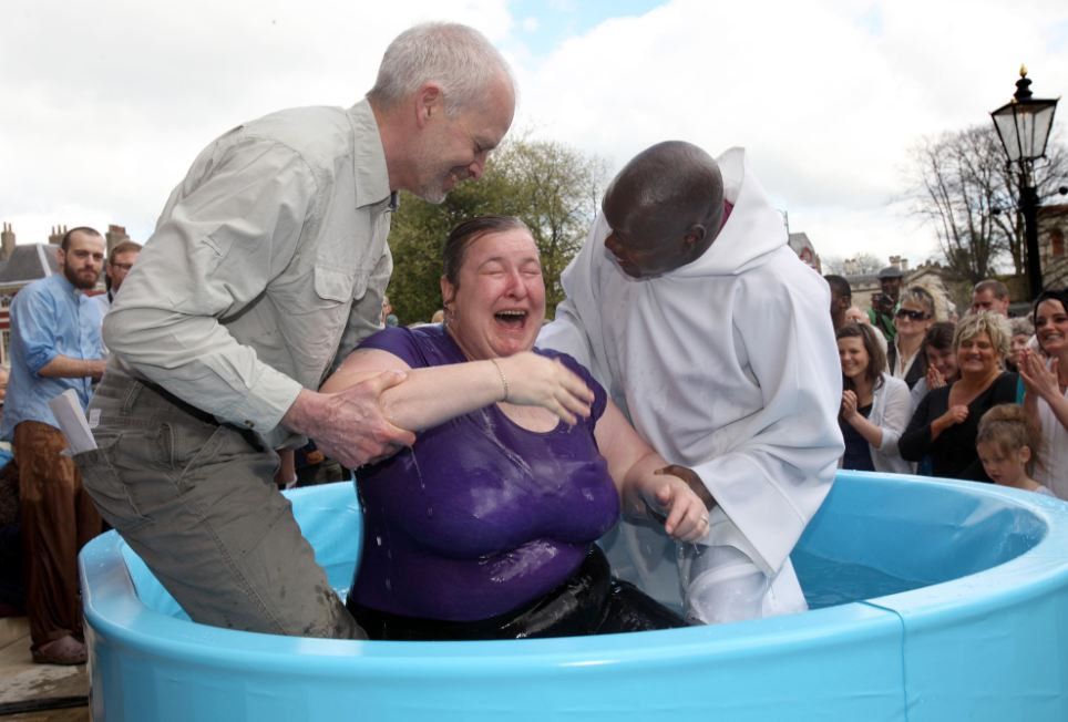Meanwhile the Archbishop of York, John Sentamu, performed traditional baptisms in a pool outside York Minster