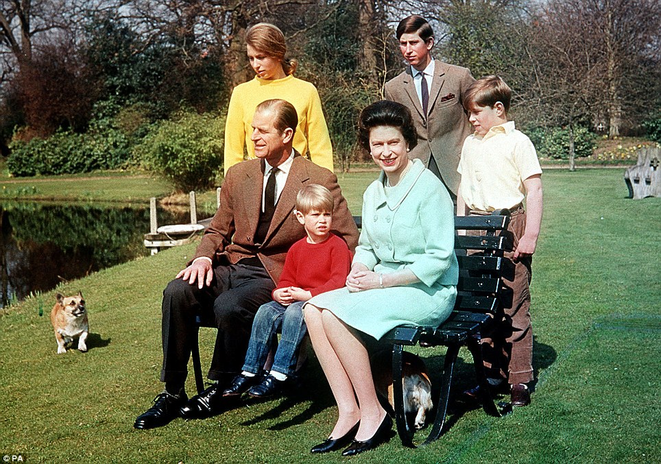 Family matters: Queen Elizabeth II looks smart in a green suit with the Duke of Edinburgh with sons  Prince Andrew (right), Prince Charles (centre back), Prince Edward and daughter Princess Anne in the garden at Frogmore Estate, Berkshire