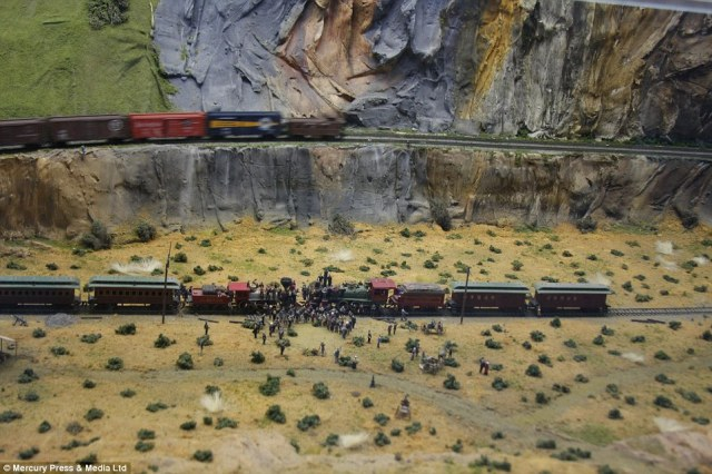 Part of the model railway shows the history of railroads across the U.S. through the years - with famous scenes including when they connected the East and West Coasts