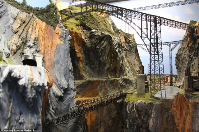 The model railways boasts an impressive 100 trains, 400 bridges and more than nine miles of track, as well as 3,000 miniature buildings that make up idyllic miniature towns and villages