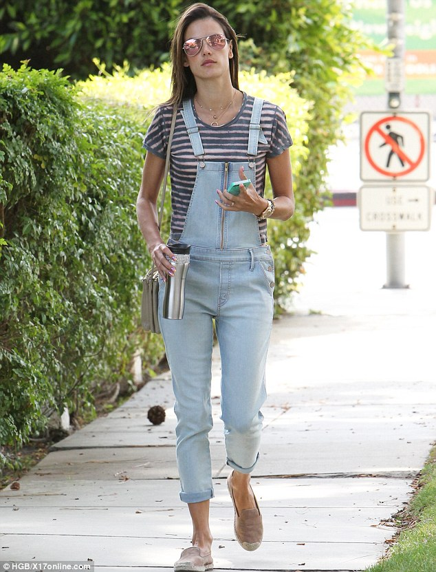 Denim delight: Alessandra Ambrosio, 33, donned a pair of overalls while on a coffee run in Brentwood, California on Tuesday