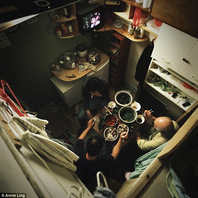 Family meal time: Workers share a late supper together with in cubicle #4, at 81 Bowery