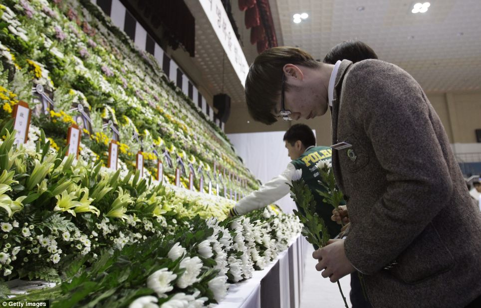Students from Danwon High School pay tribute at a group memorial altar for victims of the sunken ferry