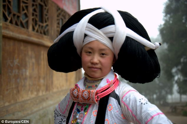 Instead of throwing away their hair when they comb it, women who are part of China's Long-horn Miao minority save the strands and add them to the collection that allows them to create spectacular headdresses