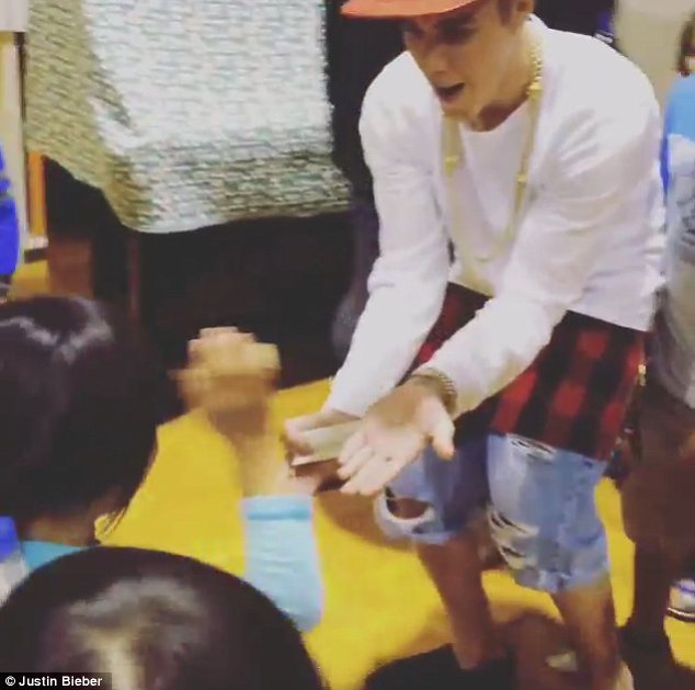 Cute as can be: While the children are probably too young to be fans of his, they certainly seemed to love Justin