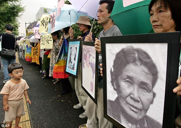 Egregious: Obama also said Japan's use of South Korean 'comfort women' during World War II was a terrible and egregious violation of human rights. Pictured: a group of Japanese protesters supporting former comfort women, or sex slaves, outside the Japanese parliament in Tokyo in 2005