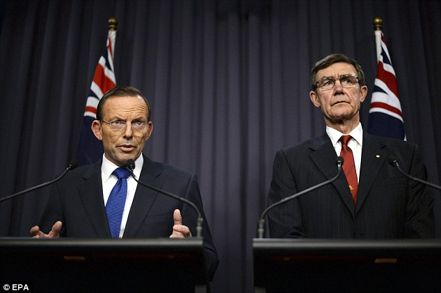 Australian Prime Minister Tony Abbott (left) and Air Chief Marshal Angus Houston announced yesterday that the search for missing Malaysian Airlines flight MH370 would move to a new face as it is now 'highly unlikely' that wreckage will be foundo n the ocean's surface