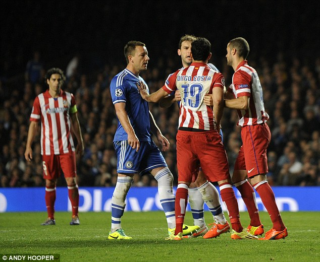 Argy bargy: John Terry squares up to some of the Atletico players as tempers fray ahead of the penalty