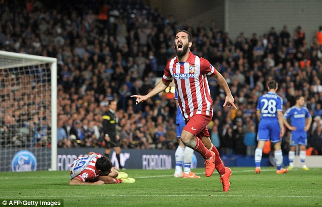 Wheeling way: Atletico's Turkish midfielder Turan celebrates his goal which books his side's final berth