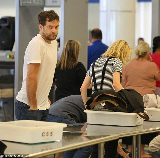 Weary: Diane, 37 and Joshua, 35, placed their belongings on the conveyor belt for scanning