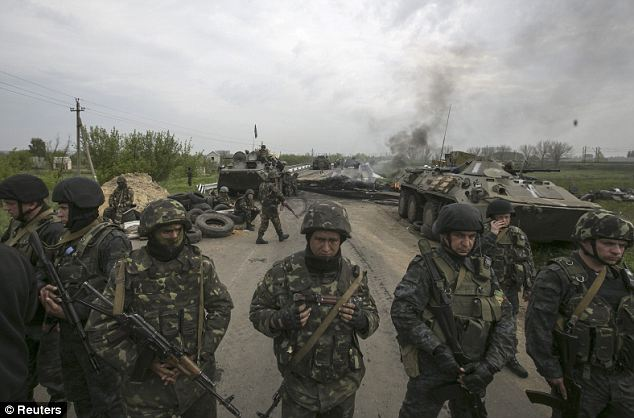 Fierce fighting: It comes as Ukrainian forces stormed the city this morning, desperate to flush out militants who have seized a number of government buildings