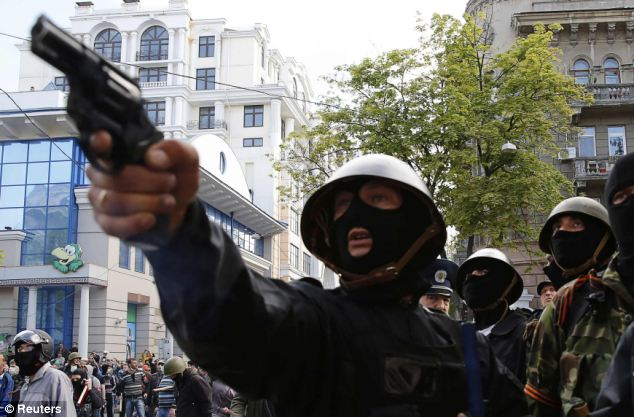 In ominous scenes, a pro-Russian activist takes aim with a revolver in Odessa, southern Ukraine