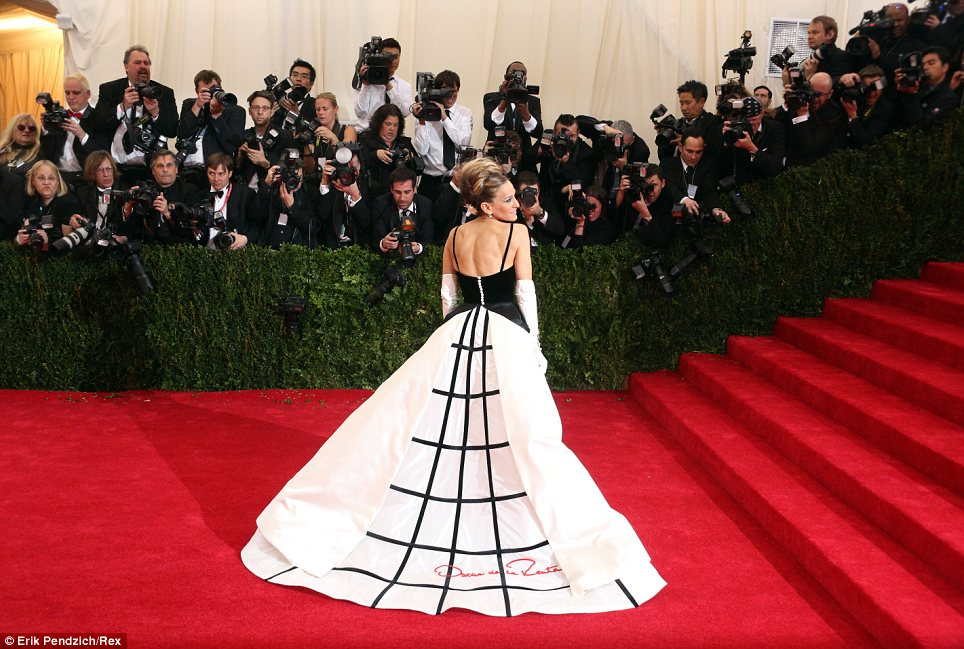 The centre of attention: Photographers scrambled to get photos of the A-listers, such as Sarah Jessica who wore a Oscar de la Renta monochrome gown, as they arrived on the red carpet