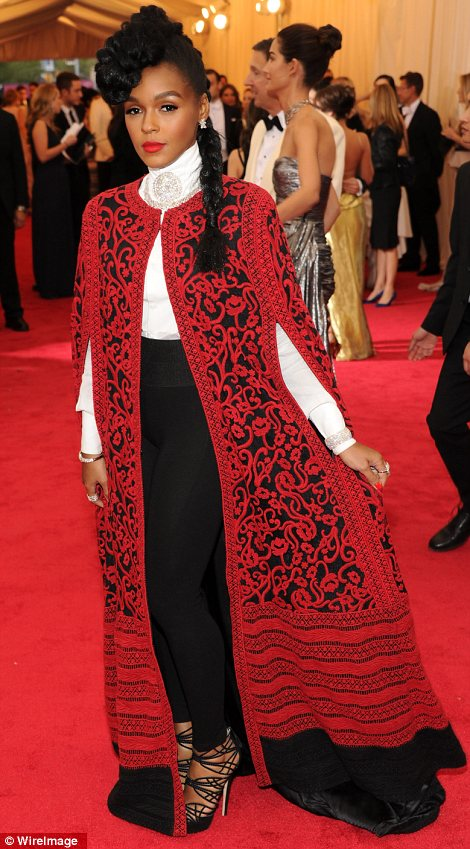 Lovely in lace: Amanda Peet (L) sported black while Janelle Monae slipped a red lace garment over her black and white outfit