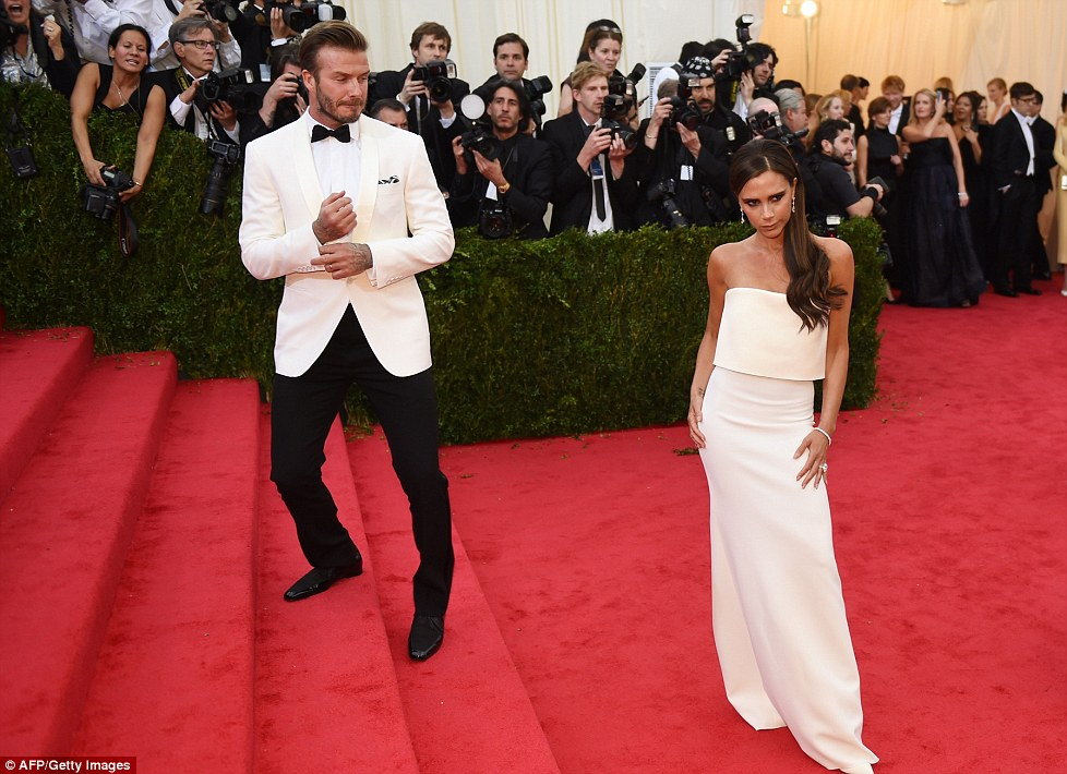 Co-ordinated couple: The Beckhams opted for a fashion throwback, once again matching their white outfits, though with considerably more success than in the 90s