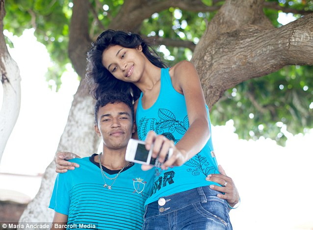 Elisany's height still draws stares, even in her hometown, but Francinaldo says the attention doesn't bother him and he is proud to show her off