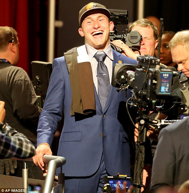 Johnny Manziel is seen leaving the stage after being selected by the Cleveland Browns at the draft