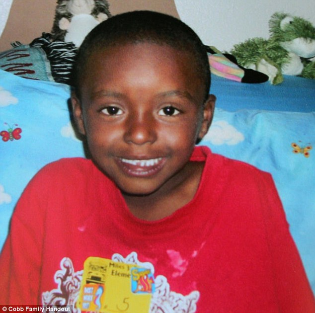Hero: 8-year-old Marty Cobb, pictured, reportedly was killed while trying to fight off a 16-year-old boy from raping his 12-year-old sister