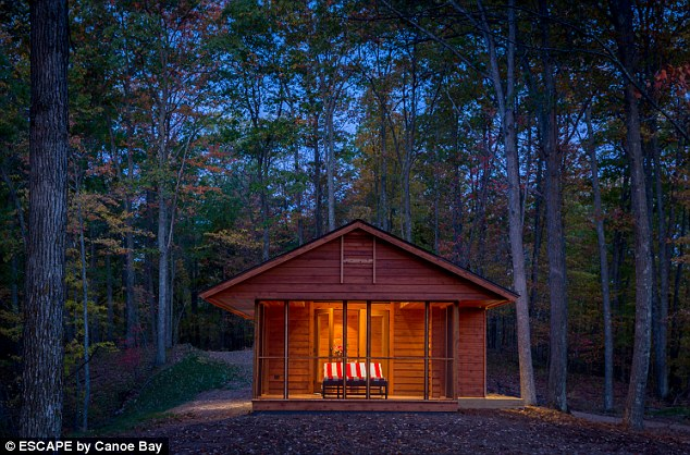Deep in the woods in Wisconsin, this little house looks like a classic weekend cabin