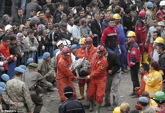Rescuers carry a miner who sustained injuries to an ambulance. The explosion, which triggered a fire, occurred shortly after 3 pm - midday GMT - on Tuesday and the death toll is feared to be rising. Local hospital shave been overwhelmed by the scale of the disaster.