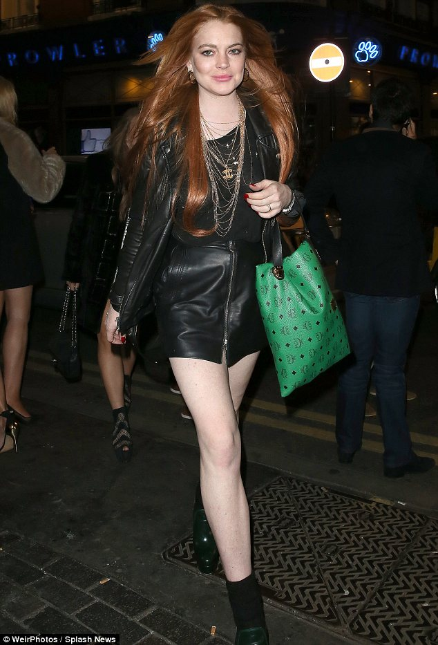 Refusing: Lindsay Lohan, pictured on Saturday in London, is allegedly saying she will not be questioned about her miscarriage and sobriety in court