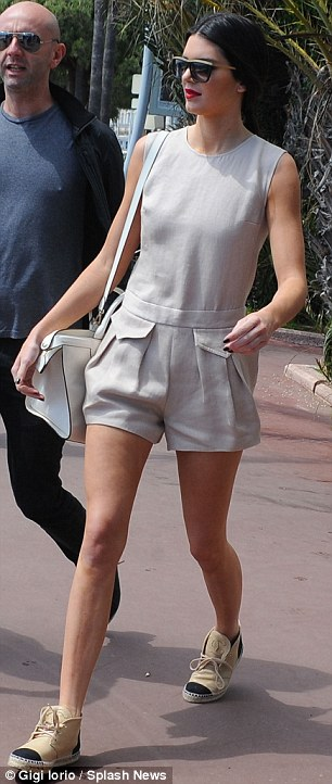 Sidewalk strut: Kendall teamed her playsuit with a pale pair of espadrilles